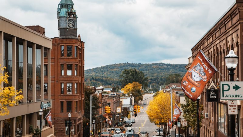 Downtown Marquette, Michigan, as seen from North Front Street in autumn, with a Kraft Hockeyville banner.